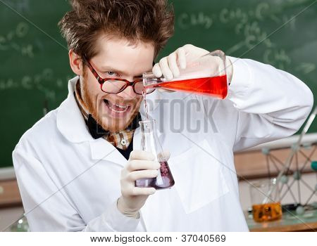Crazy scientist mixes two liquids in his laboratory