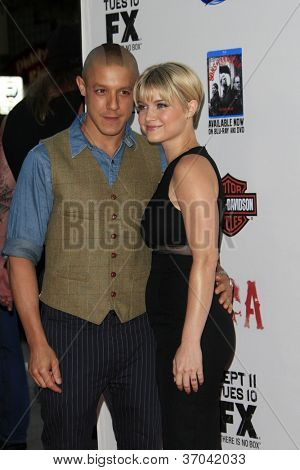 "LOS ANGELES - SEP 8:  Theo Rossi. Sarah Jones arrives at the ""Sons of Anarchy"" Season 5 Premiere Screening at Village Theater on September 8, 2012 in Westwood, CA"