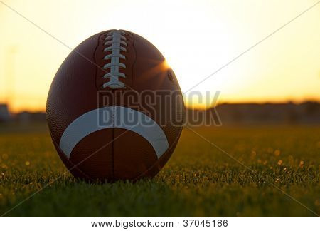 American Football on the Field backlit by the sun with room for copy