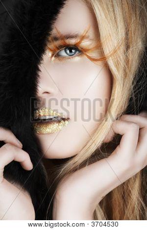Gold Leaf And False Eyelashes On A Blond Woman
