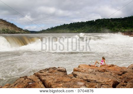 Woman With Waterfall In Background