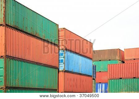 Stack of Cargo Containers  awaiting transportation on the white background  in a harbor