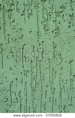green striated stucco wall texture
