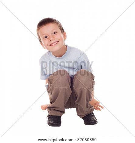 surprised boy sit down