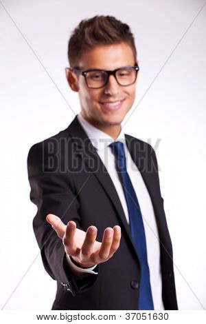 young business man wearing glasses and holding something on his hand