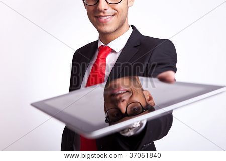 closeup of a young business man offering to you a brand new touch screen pad