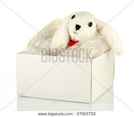 Opened parcel with a child's toy isolated on white