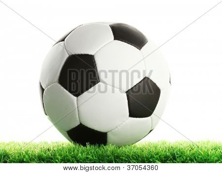 football ball on green grass, isolated on white