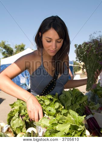 Beautiful Woman Shopping For Greens At The Market