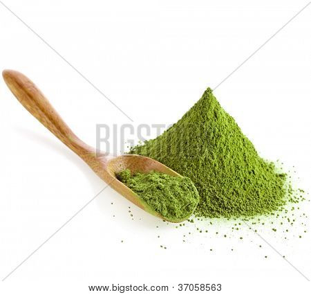 powdered green tea with bamboo spoon ,  isolated on white background
