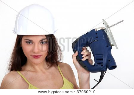 Woman with an electric jigsaw