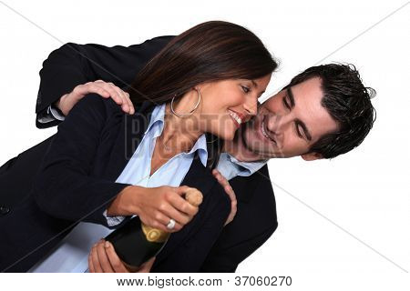 couple with bottle of champagne