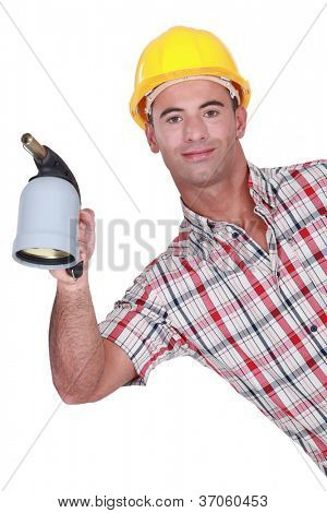 Workman with a blowtorch