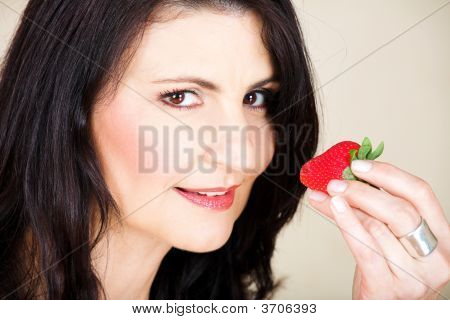 Happy Mature Woman With Strawberry