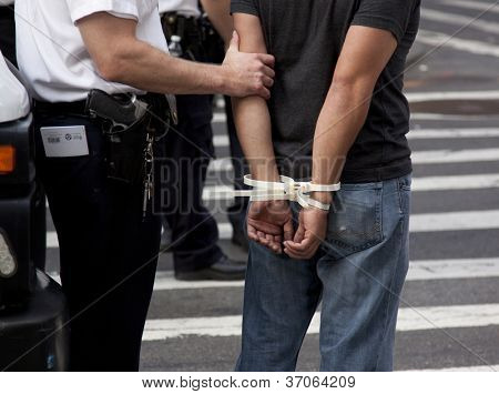 NEW YORK - SEPT 17: Plastic handcuffs on an unidentified man being arrested during the 1yr anniversary of the Occupy Wall St protests on September 17, 2012 in New York City, NY.