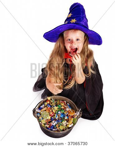 Witch  little girl with group candy. Halloween.