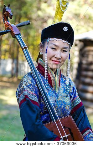 ULAN-UDE, RUSSIA - SEPTEMBER 13:Unidentified women in Buryat traditional costume. Costume show at Baikal Economic Forum, September 13, 2012 in Ulan-Ude, Buryatia, Russia