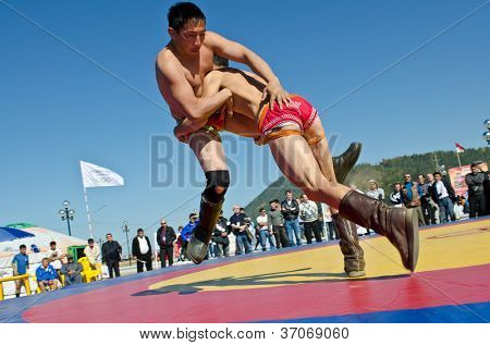 ULAN-UDE, RUSSIA - SEPTEMBER 13: Cultural program of the Baltic Economic Forum. Show of young athletes in the national struggle