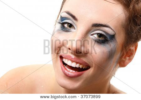 hysterics crying and smiling woman with wet makeup over white background