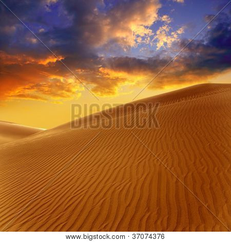 Desert sand dunes in Maspalomas sunset Gran Canaria at Canary islands [Photo illustration]