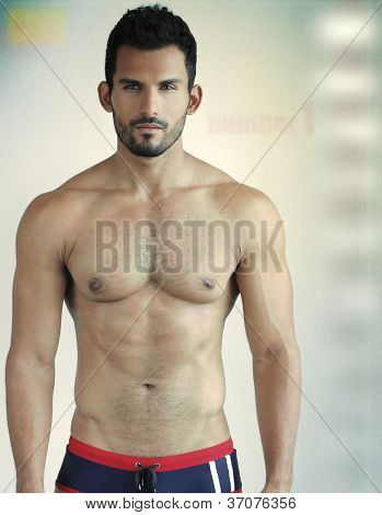 Sexy young man portrait against modern background