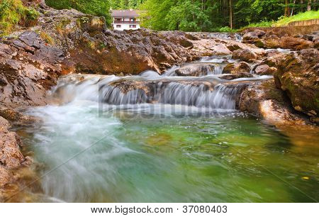 Waterfall on a mountain river Konigsseer Ache in Berchtesgaden national park, Bavaria, Germany.