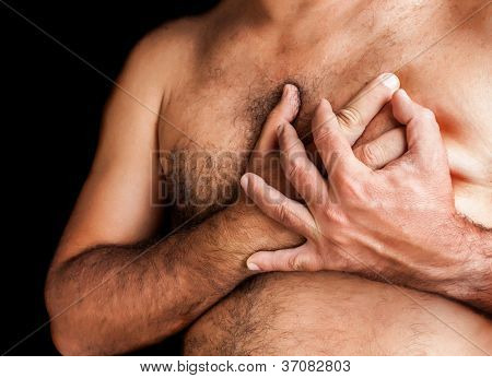 Shirtless man suffering a heart attack and grabbing his chest