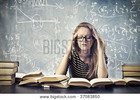 Beautiful blonde girl stressed by the study