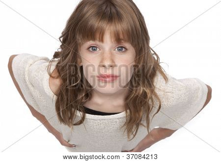 Cute eleven year old girl looking up at camera, on white background.