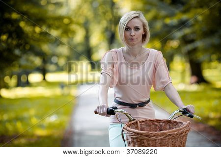 Female biker in a park