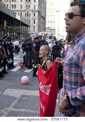 NEW YORK - SEPT 17: Protesters on the sidewalk face a line of policemen on Broadway near Wall St during the 1yr anniversary of the Occupy Wall St protests on September 17, 2012 in New York City, NY.