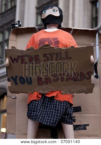 NEW YORK - SEPT 17: A sign that reads 'We're Still Here' held by a protester in Zuccotti Park during on the 1yr anniversary of the Occupy Wall St protests on September 17, 2012 in New York City, NY.