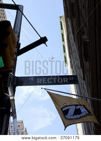 NEW YORK - SEPT 17: A helicopter hovers above Rector St and Broadway during the 1yr anniversary of the Occupy Wall St protests on September 17, 2012 in New York City, NY.