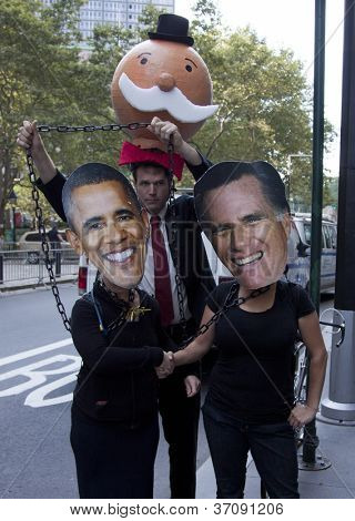 NEW YORK - SEPT 17: Protesters wearing Barrack Obama and Mitt Romney masks shaking hands on the 1yr anniversary of the Occupy Wall St protests on September 17, 2012 in New York City, NY.