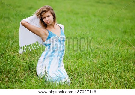 The beautiful woman in a blue dress