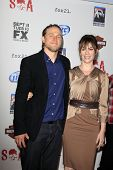 LOS ANGELES - SEP 8:  Charlie Hunnam, Maggie Siff arrives at the