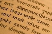 stock photo of sanskrit  - The Sanskrit verse from Great Bhagavad Gita