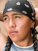 stock photo of facial piercings  - Portrait of a handsome 15 year old Native American boy - JPG