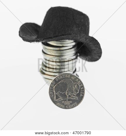 American Bison Nickel With Cowboy Hat On A Stack Of Nickels