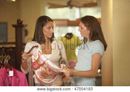 Women selecting clothes in shop