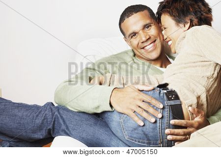 Man holding his girlfriend on his lap