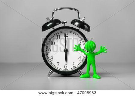Green man and an alarm clock.