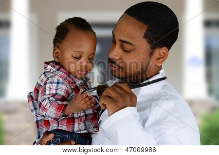 Minority male doctor working in a hospital