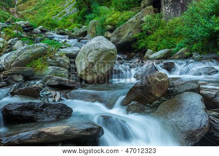 Cascade of Bhagsu waterfall in Himalayas. Bhagsu, Himachal Pradesh, India. Polarizer filter used