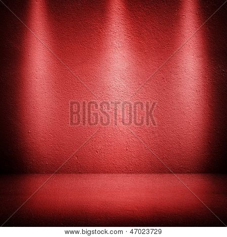 red wall with spot lights