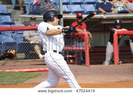 Binghamton Mets batter Daniel Munto swings  at a pitch