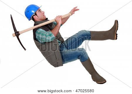 Man with pick-axe falling