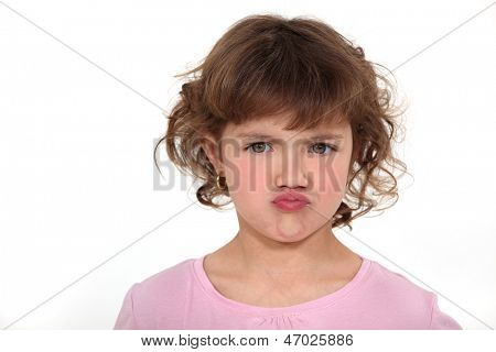 Young girl screwing up her face