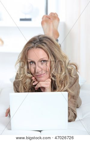 blonde woman working from home