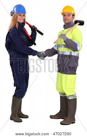 Tradespeople shaking hands